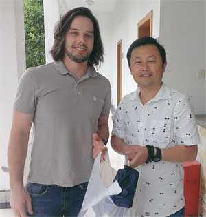 Patrick delivering GPS Collars  to Huang Yan